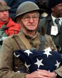Joseph Ambrose, an 86-year-old en:World War I veteran, attends the dedication day parade for the Vietnam Veterans Memorial in 1982. He is holding the flag that covered the casket of his son, who was killed in the Korean War. Photo credit: U.S. Census Bureau.