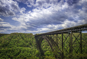 View of the New River Gorge Bridge from the overlook at the north end of the New River Gorge (facing southwards), near Fayetteville, West Virginia. Taken May 5, 2013 using an Olympus E-3 DSLR by Shawn Ullerup.